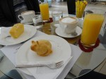 """This was the breakfast we ordered. Fresh orange juice, Wiener Melange, lemon cake and """"Vanilla Kitten"""" (freshly baked and still fuming!). The cakes were brought under glass cups that the waitress only removed once the plates were on our table. Yummy, and average price for a Kaffee in this area."""